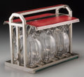 Decorative Arts, French, A Jacques Adnet Art Deco Nickel-Plated, Leather and Glass Tantalus,circa 1940. 10-1/8 h x 12-7/8 w x 7-1/2 d inches (25.7 x...