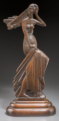 Decorative Arts, Continental, A Locwit Art Deco Carved and Stained Oak Statue of a Woman, firsthalf 20th century. Marks: LOCWIT. 26 inches high (66.0...