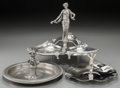Decorative Arts, Continental, A Group of Three Art Nouveau and Art Deco Metal Trays with FiguralStandards, early 20th century. Marks: (various marks). 10...(Total: 3 Items)