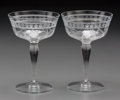 Decorative Arts, Continental, A Set of Nine Glass Champagne Coupes with Intaglio Floral Design,20th century. 5-7/8 inches high (14.9 cm). ... (Total: 9 Items)