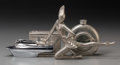 Decorative Arts, Continental, Four Pewter and Chromed Metal Desk Articles: Flask, Dancer, BoatLighter, Playing Card Box, 20th century. 4-3/4 inches high ...(Total: 4 Items)