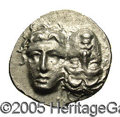 Ancients:Greek, Ancients: Moesia, Istros. Ca. 4th century B.C. AR drachm (18 mm,5.81 g). Facing male heads, the right inverted / Sea-eagle flyinglef...