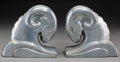 Decorative Arts, American, A Pair of Art Deco-Style Silvered Metal Ram's Head Bookends, 20thcentury. 5-3/4 inches high (14.6 cm). ... (Total: 2 Items)