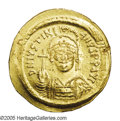 Ancients:Byzantine, Ancients: Justinian I. A.D. 527-565. AV solidus (22 mm, 4.50 g).Constantinople, A.D. 545-565. Diademed, helmeted and cuirassed bustf...