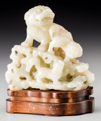 A Chinese Carved White Jade Figure: Fu Lion Group on Open Rockwork, Qing Dynasty, 18th -19th century 4-5/8 inches