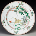 Asian:Chinese, A Chinese Famille Verte Porcelain Deer Charger, QingDynasty, Kangxi Period, circa (1662-1722). 14 inches diamet...
