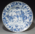 Asian:Chinese, A Chinese Blue and White Porcelain Dish, Qing Dynasty, KangxiPeriod, circa 1662-1722. Marks: Kangxi six-character mark in u...