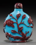 Asian:Chinese, A Fine Chinese Cinnabar Red Overlay Sky Blue Glass Snuff Bottle,Qing Dynasty, 19th century. 2-1/4 inches high (5.7 cm). ...
