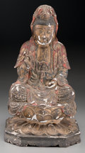 Asian:Other, A Chinese Parcel Gilt and Polychromed Wooden Figure of SeatedGuanyin, late Ming Dynasty . 16-3/8 inches high (41.6 cm). ...