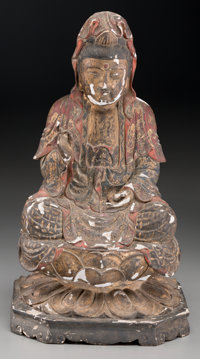 A Chinese Parcel Gilt and Polychromed Wooden Figure of Seated Guanyin, late Ming Dynasty 16-3/8 inches high (41.6