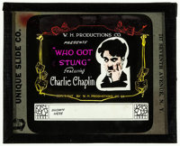 "Caught in the Rain (W.H. Productions, R-1918). Glass Slide without paper holder (3.25"" X 4"") Reissue Title: Wh..."