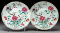 Paintings, A Near Pair of Chinese Famille Rose Porcelain Chargers, Qing Dynasty, 19th century. Marks: Kangxi four-character mark in und... (Total: 2 Items)