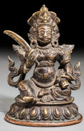 Asian:Chinese, A Tibetan Bronze Seated Deity with Sword on Lotus Base, MingDynasty, 16th-17th century. Marks: Incised flower to underside...