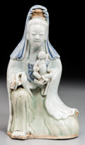 Asian:Chinese, A Chinese Polychrome Glazed Porcelain Guanyin with Child, QingDynasty, 17th century. 7-5/8 inches high (19.4 cm). ...