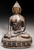 Asian, A Large Bronze Figure of Buddha Shakyamuni. Marks: (incised flowerto underside). 12-7/8 inches high x 9 inches wide (32.7 x...