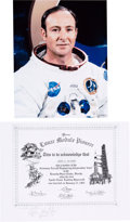 """Autographs:Celebrities, Edgar Mitchell Signed Grumman """"Lunar Module Pioneer"""" Certificatewith White Spacesuit Color Photo.... (Total: 2 )"""