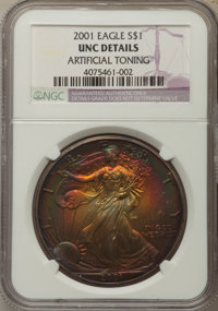 2001 $1 Silver Eagle -- Artificial Toning -- NGC Details. UNC. And a 2002 $1 Silver Eagle -- Artificial Toning -- NGC De...