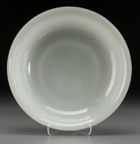 A Fine Chinese White Jade Shallow Footed Dish, Qing Dynasty, Qianlong Period, circa 1736-1795 2 inches high x 10-1