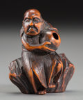 Asian:Japanese, A Japanese Carved Boxwood Netsuke of a South Sea Islander, EdoPeriod, 18th century. Marks: Signed Issai to the underside. 1...