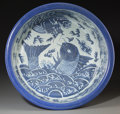 Asian:Chinese, A Chinese Blue and White Carp and Dragon Basin, QingDynasty, 19th century. 5-5/8 inches high x 16 i...