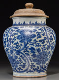 Asian:Chinese, A Chinese Blue and White Porcelain Peony Jar, TransitionalPeriod, 17th century. 14-1/2 inches high (36.8 cm) (j...