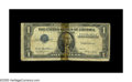 Error Notes:Inverted Third Printings, Fr. 1614 $1 1935E Silver Certificate. Very Good. An interestinginverted third printing on this silver certificate. Unfortun...