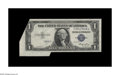 Error Notes:Foldovers, Fr. 1614 $1 1935E Silver Certificate. Choice Crisp Uncirculated.This Silver Ace received the first two printings in a three...