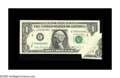 Error Notes:Foldovers, Fr. 1914-E $1 1988 Federal Reserve Note. About Uncirculated.. Thisprinted fold error off Richmond shows a portion of the ne...