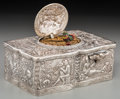 Silver Holloware, Continental, A German Silver Singing Bird Automaton Box, late 19th century.Marks: 800, (effaced mark). 1-1/2 h x 4-1/8 w x 2-5/8 d i...