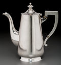 Silver Holloware, Continental, A Russian Planished Silver Coffee Pot, mid-19th century. Marks:CTB, (rubbed Assayer's mark), 84, (town mark),875...