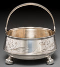 Silver Holloware, Continental, A Russian Silver Handled Sugar Basket, circa 1896-1908. Marks:(left-facing kokoshnik-84), (rubbed mark), BC. 5 inches h...