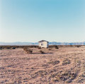 Photographs:Chromogenic, John M. Divola (American, b. 1949). Isolated House, 1995.Dye coupler. 14 x 14 inches (35.6 x 35.6 cm). Signed and dated...