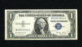 Error Notes:Skewed Reverse Printing, Fr. 1614 $1 1935E Silver Certificate. Very Fine-Extremely Fine. Theback printing is skewed enough to show a nice portion of...