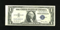 Error Notes:Skewed Reverse Printing, Fr. 1614* $1 1935E Silver Star Certificate. Choice AboutUncirculated. This Star with a skewed back printing has a lightcor...