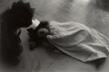 Photographs:Gelatin Silver, Sheila Metzner (American, b. 1939). Untitled (Girl with crown napping on the floor). Gelatin silver. 5-1/8 x 7-1/2 inche...