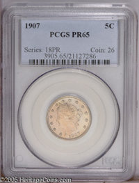 1907 5C PR65 PCGS. Speckles of milky-tan patina dot the well preserved mirrored surfaces. All of the design features are...