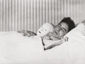 Photographs, Berenice Abbott (American, 1898-1991). Jean Cocteau lying with the mask of Antigone, 1927. Gelatin silver, printed 1970s...