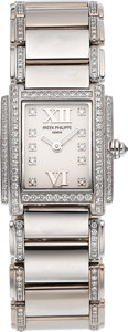 Timepieces:Wristwatch, Patek Philippe Ref. 4908/310G Lady's White Gold & DiamondBracelet Watch. ...