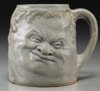 Martin Brothers Glazed Stoneware Double-Sided Face Mug Circa 1900. Engraved R. W. Martin + Bros., London + Sout