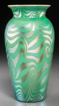 Glass, Durand Swirled Lustre Green Glass Vase. Circa 1925. Enameled DURAND, 1712. Ht. 8-3/4 in.. ...