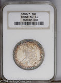 Bust Half Dollars: , 1808/7 50C AU53 NGC. O-101, R.1. Mostly untoned in the centers withrings of amber, maroon, and cobalt-blue color around th...