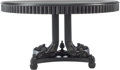 Furniture , A Large Ebonized Center Table in the Regency Taste, 21st century. 30-1/2 inches high x 58-1/2 inches diameter (77.5 x 148.6 ...