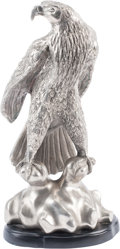 Decorative Arts, Continental, A Silvered Metal Figure of an Eagle, 21st century. 17-3/4 h x 9 w x6 d inches (45.1 x 22.9 x 15.2 cm). ...