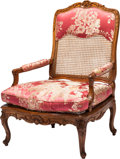 Furniture : French, A French Régence Carved Oak and Caned Upholstered Fauteuil withPillow, 18th century. 40 h x 28 w x 25 d inches (101.6 x 71....(Total: 2 Items)