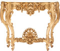 Furniture : Continental, An Italian Rococo-Style Carved Giltwood Console Table with OnyxTop, circa 1900. 41 h x 48-1/2 w x 19 d inches (104.1 x 123....(Total: 2 Items)