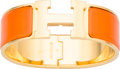 """Luxury Accessories:Accessories, Hermes Orange Enamel Wide Clic Clac PM Bracelet with Gold Hardware. Excellent Condition. 1"""" Width x 6.5"""" Length. ..."""