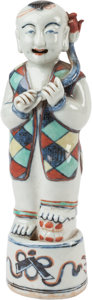 Asian:Chinese, A Chinese Porcelain Figure of a Ho Ho Boy. 10 inches high x 3inches wide (25.4 x 7.6 cm). ...