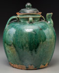 Asian:Chinese, A Chinese Green-Glazed Lidded Earthenware Pitcher. 10 inches high(25.4 cm). COLLECTION OF DR. FLO AND FRED WIEDEMANN, DAL...