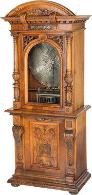 A Large German Renaissance-Style Coin Operated Carved and Burled Walnut Polyphon Music Cabinet, circa 1900 82-3/4