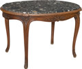 Furniture : French, A Louis XIV-Style Carved Walnut Salon Table with Marble Top, 19thcentury. 30-1/4 h x 46-1/2 w x 34-1/4 d inches (76.8 x 118...